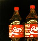Coca Cola bottles- hyperrealism acrylic still life painting by artist Gerard Boersma showing coca cola bottle