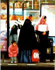 Dirk- hyperrealism painting by artist Gerard Boersma showing muslim women waiting for tram at central station in Amsterdam