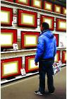 Flat Screens- stores and interiors- hyperrealism  painting of man in Media Markt electronic shop by artist Gerard Boersma