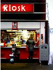 Kiosk- hyperrealism public transport painting of a woman buying something at a kiosk on central station in Zwolle by artist Gerard Boersma