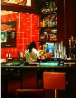 Las Vegas Bar- hyperrealism acrylic painting by artist painter Gerard Boersma showing a woman working in a bar in Las Vegas