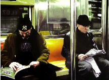 subway- hyperrealism painting by artist Gerard Boersma showing two men riding subway metro in New York