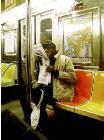 Surrounding- hyperrealism public transport painting of a man riding the New York subway metro by artist Gerard Boersma