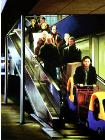 product- hyperrealism acrylic painting by artist painter Gerard Boersma showing people leaving ikea with escalator