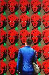 Red Marilyns- museum and art within art- hyperrealism painting of man enjoying painting of Marilyn Monroe by Andy Warhol