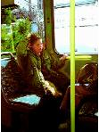 Stadsbus- hyperrealism subway and transport painting of woman with down syndrome riding the bus by artist Gerard Boersma