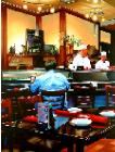 Sushi Bar- hyperrealism acrylic painting by artist painter Gerard Boersma showing a man in a sushi bar