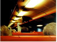 Train Carriage- hyperrealism public transport painting of people riding a train by night by artist Gerard Boersma