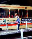 Tram Platform- hyperrealism public transport painting of people a woman waiting for her tram on platform in The Hague by artist Gerard Boersma
